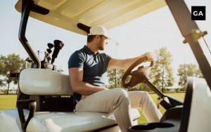 male golfer sitting on his golf cart