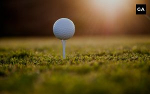 golf tee with a ball on it in the morning light