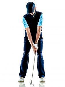 male golfer setting up at address