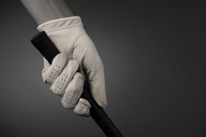 golf glove gripping a club