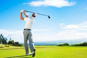 male golfer swinging on the golf course