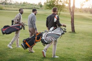 3 golfers walking with bags