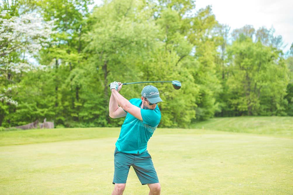 golfer swinging his driver
