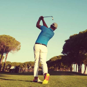 Golf Player Swinging His Club