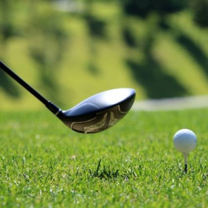 Driver and golf ball on a tee