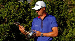 Justin Thomas holding Players trophy