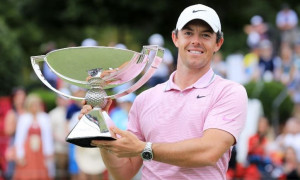 Rory Holding PGA championship trophy