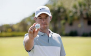 Rory holding his TaylorMade TP5 ball